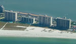 Aerial Picture of Landmark Towers, Harbor Light, and Lighthouse Towers.  Buildings directly on the Gulf of Mexico in Sand Key Florida